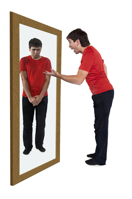 Man scolding himself in a mirror