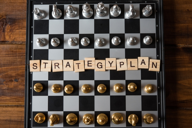"Chess board and text ""Strategic plan"" Business planning concept"